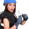 Woman with electric wire and pliers - Stock Photo