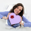 Stock Photo: Womholding heart-shaped box