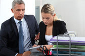 Boss and secretary working together — Stock Photo