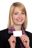 Woman showing card — Stock Photo