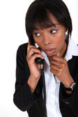African woman on the phone — Stock Photo