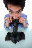 Man pretending to play a console — Stock Photo