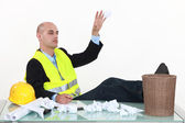 An architect throwing drafts in the garbage cans. — Stock Photo