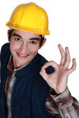 Young craftsman being glad — Stock Photo