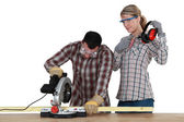 Carpenter with chainsaw — Stock Photo