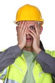 Tradesman afraid to look — Stock Photo