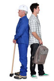 Senior man and younger with backpack — Stock Photo