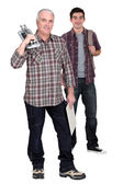 Tile cutter with young male apprentice — Stock Photo