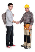 Experienced tradesman meeting new apprentice — Stock Photo