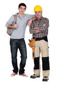 A handyman and his trainee. — Stock Photo
