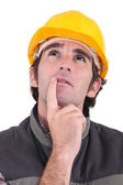Tradesman deep in thought — Stock Photo