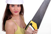 Young woman with a saw — Stock Photo