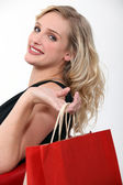 Blond woman returning from shopping trip — Stock Photo