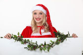Miss Santa with a board left blank for your message — Stock Photo