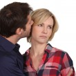 Man whispering in an unhappy woman — Stock Photo #16770451