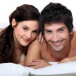 Portrait of a young couple in bed — Stock Photo #16777803