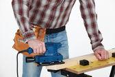Man using a jigsaw — Stock Photo