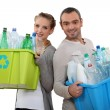 Couple recycling empty plastic bottles — Stock Photo