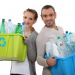 Stock Photo: Couple recycling empty plastic bottles