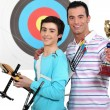 Stock Photo: Father and son trophy and bow