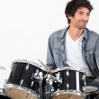 Young playing drums — Stock Photo