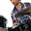 Portrait of a man playing drums — Stock Photo
