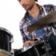 Stock Photo: Portrait of mplaying drums