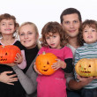 Family with carved pumpkins — Stock Photo