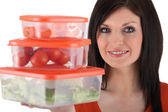 Woman holding plastic food storage — Stock Photo