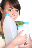 Woman with empty plastic bottles — Stock Photo