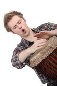 Oblique image of boy playing drum — Stock Photo