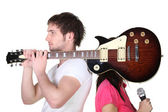 Boy with guitar over shoulder — Stock Photo