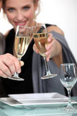 A couple celebrating with a glass of champagne — Stock Photo