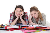 Two female friends revising together — Stok fotoğraf