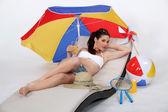 Studioaufnahme einer Frau am Strand — Stockfoto