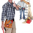 Stock Photo: Two carpenter with step ladder