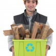 A construction worker recycling wooden scraps. — Stock Photo