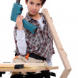 Little boy dressed like a craftsman holding a drill — Stock Photo #16797095