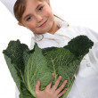Girl carrying cabbage head — Stock Photo #16797281