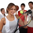 Foto Stock: Teenagers dressed for different sports