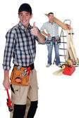 Two carpenter with step ladder — Stock Photo