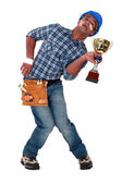 Accident prone construction worker holding a trophy — Stock Photo