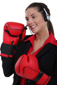 Customer service agent wearing boxing gloves — Stock Photo