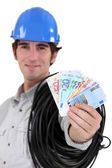 Electrician showing wad of bills — Stock Photo