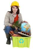 Female builder with recyclable waste — Stock Photo