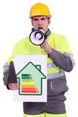 Craftsman holding a megaphone — Stock Photo