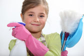Girl with cleaning products — Stock Photo