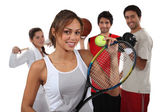 Teenagers dressed for different sports — Stock Photo