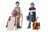 Two children acting out adult trades - carpentry and construction — Stock Photo