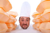 Cook with stacks of packagings — Stock Photo